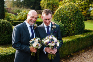 Groom and best man with flowers