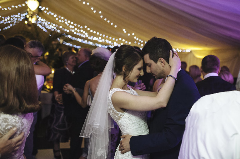couple sharing intimate moment during first dance
