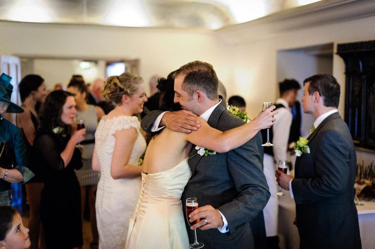 groom hugging sister