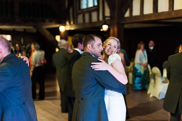 smiling bride dancing with groom