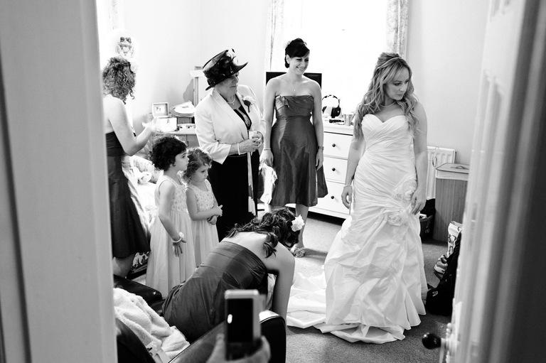 bride admires dress in mirror