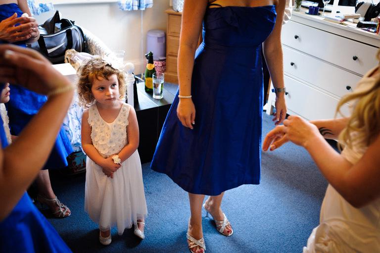 little bridesmaid admiring