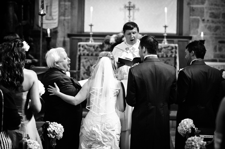 bride groom father at the altar