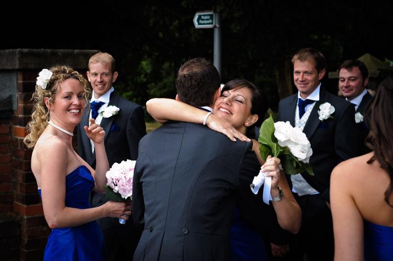 groom bridesmaid hug