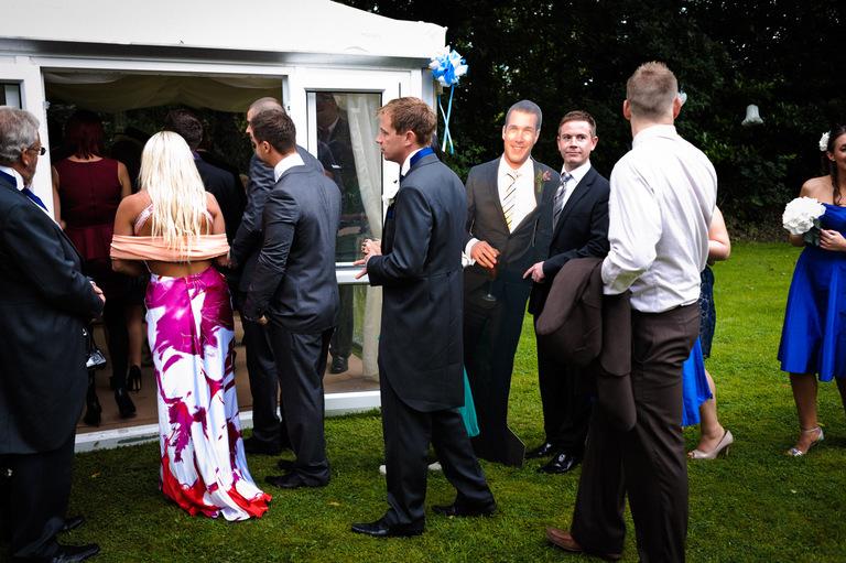 wedding guests queue with cardboard cutout