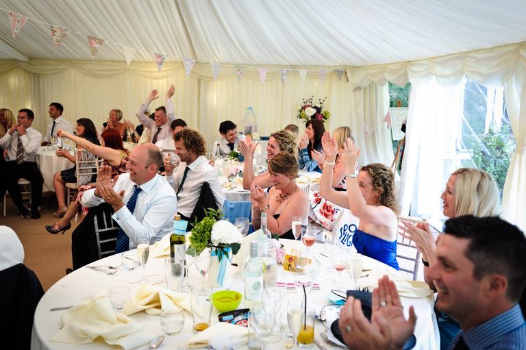 cheering wedding guests