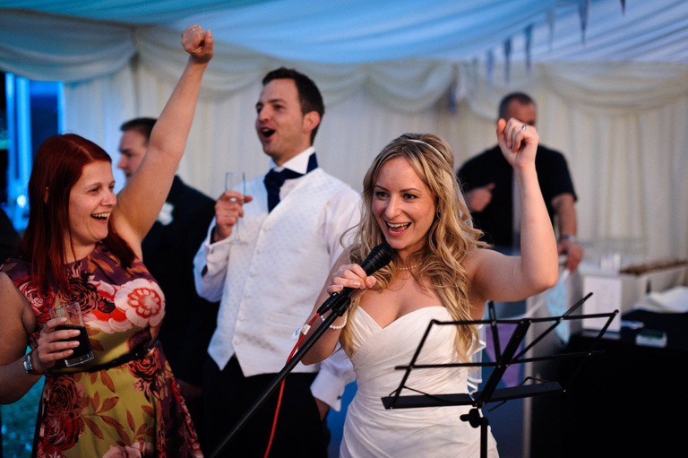 cheering bride and groom
