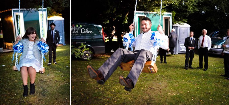 wedding guests playing on a tree swing