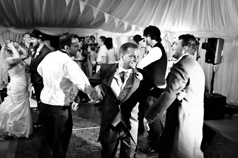 male wedding guests dancing