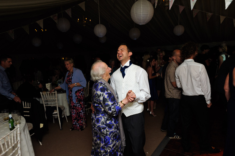 groom dancing with his grandma