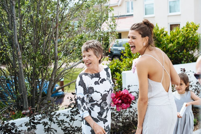 bride with her mother laughing