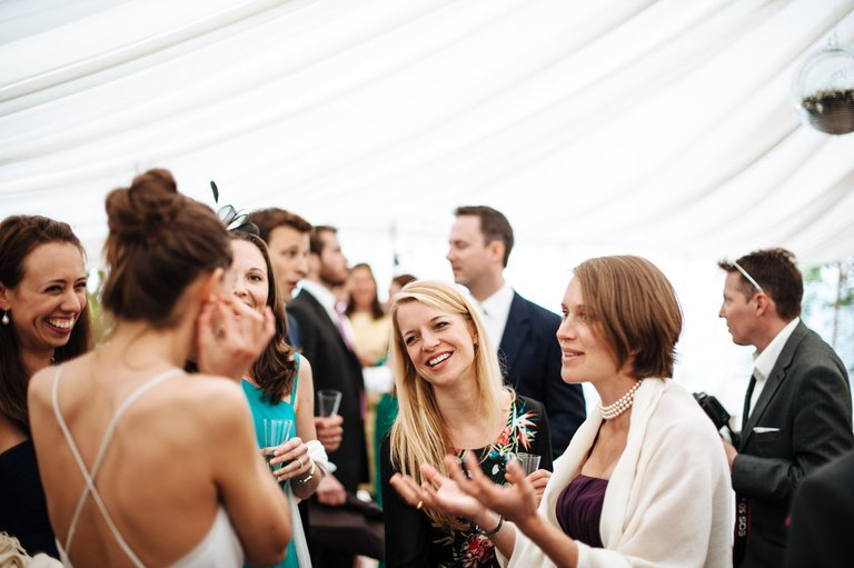 smiling female wedding guests