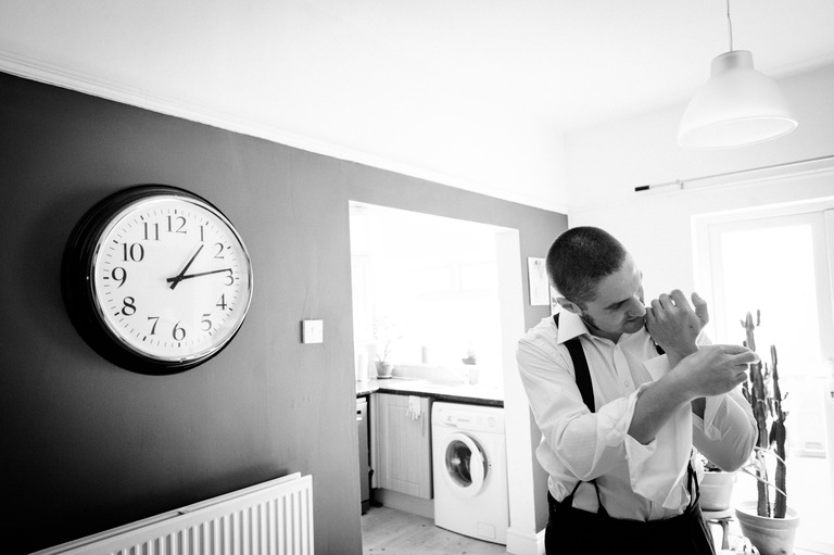 groom sorting out his cufflinks