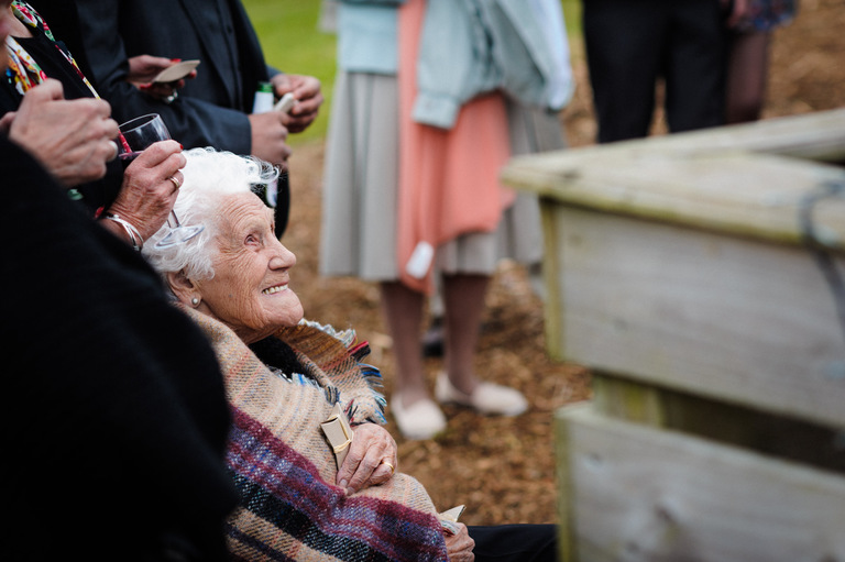 happy granny at an outdoor wedding