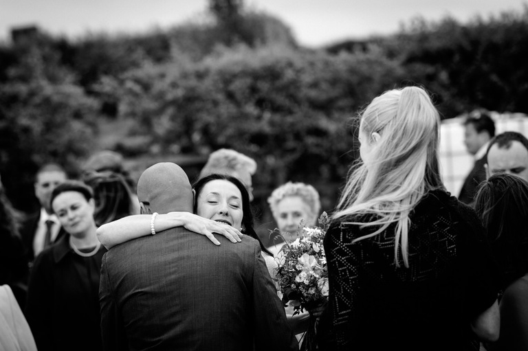 outdoor wedding hugs