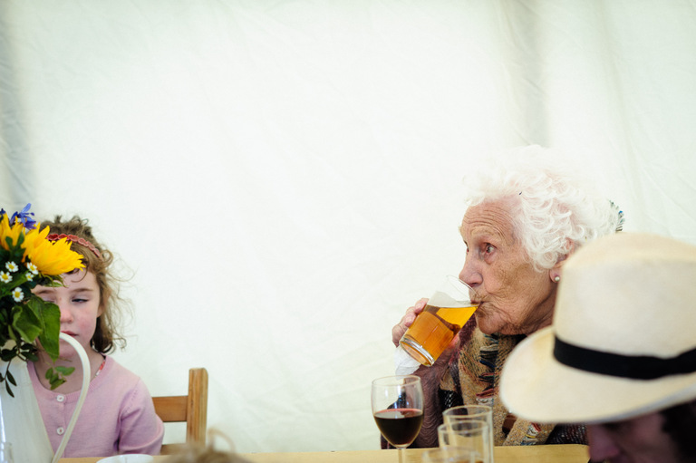 grandma with her lager at a wedding