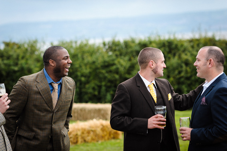 groom laughing with his friends