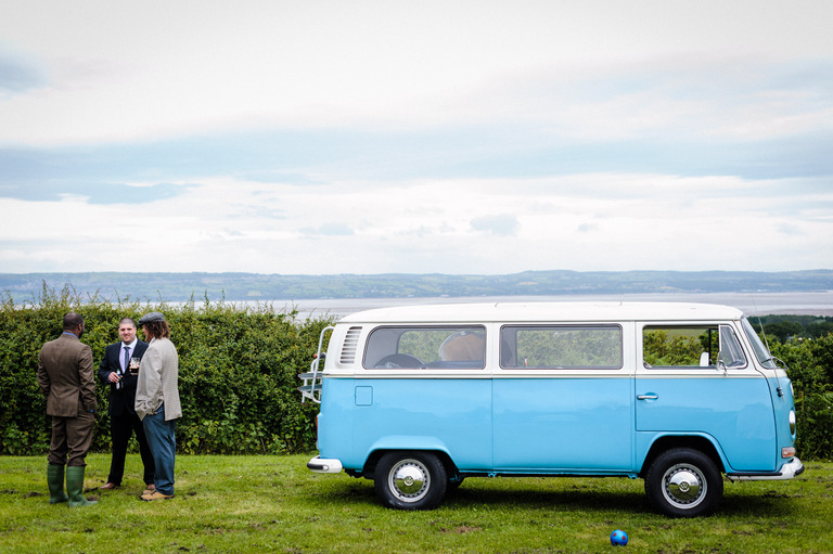 groom next to blue camper van lancashire