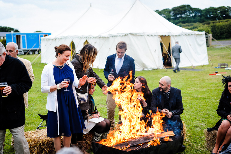 wedding guests fire pit hay bales