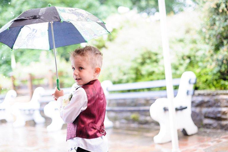 page boy with umbrella