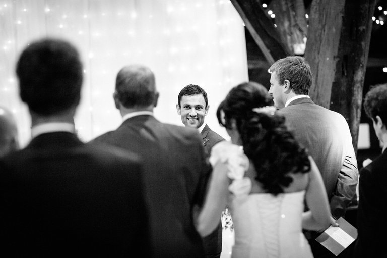 groom watching bride lancashire wedding