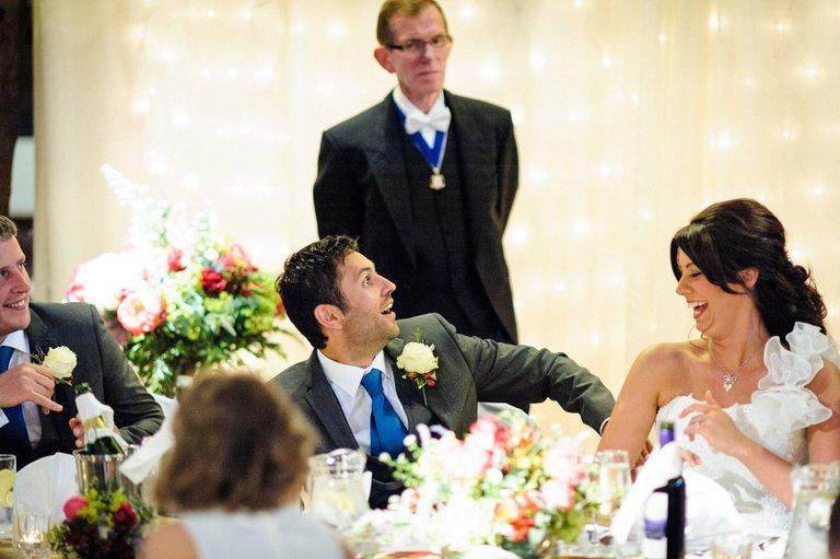 shocked looking groom during speeches