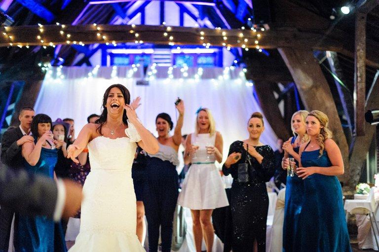 rivington barn bride bouquet toss