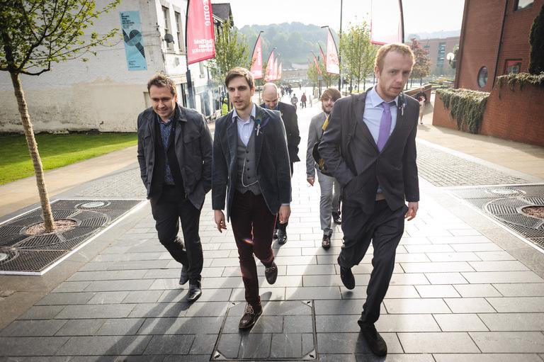 groom and mates walking to wedding through sheffield