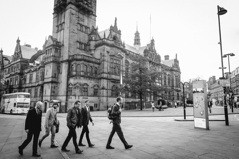 groom with friends walking sheffield city centre