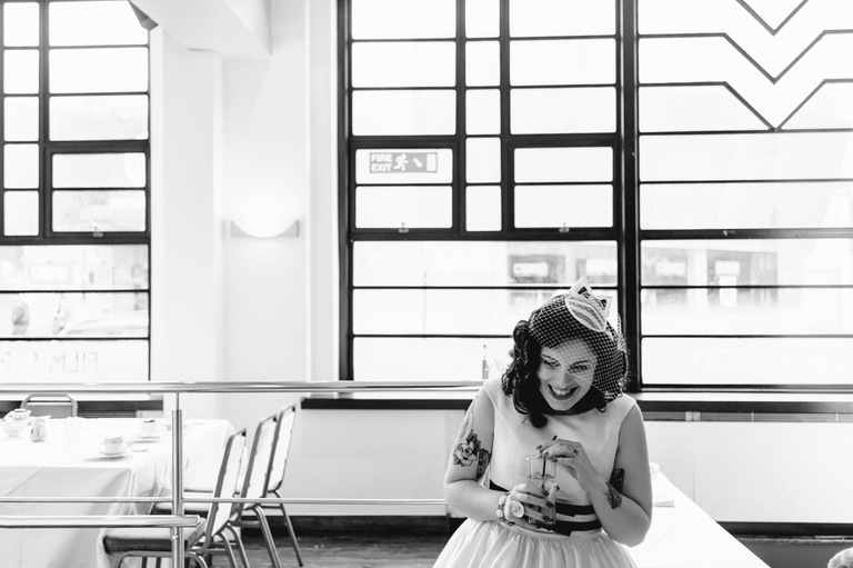 laughing bride with drink