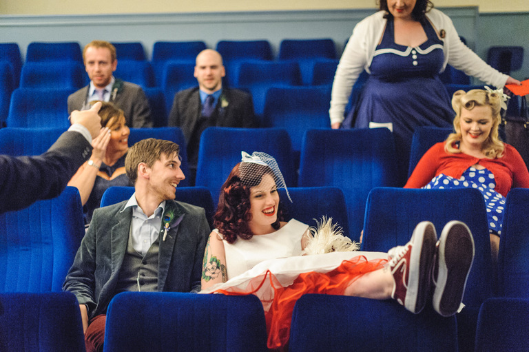 married couple with guests in cinema wedding