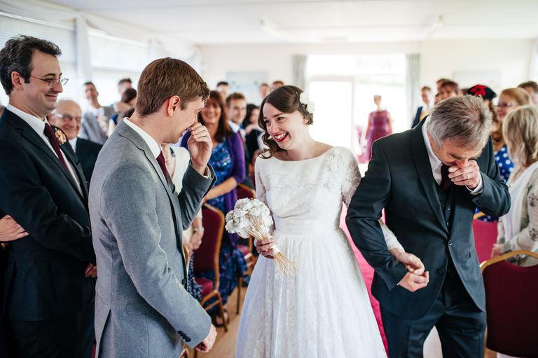 emotional bride meets groom at altar