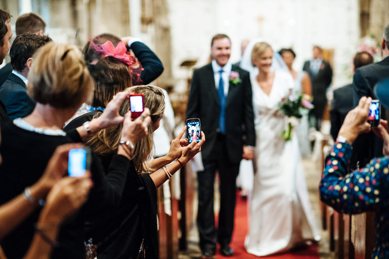 mobile phones walking down the aisle