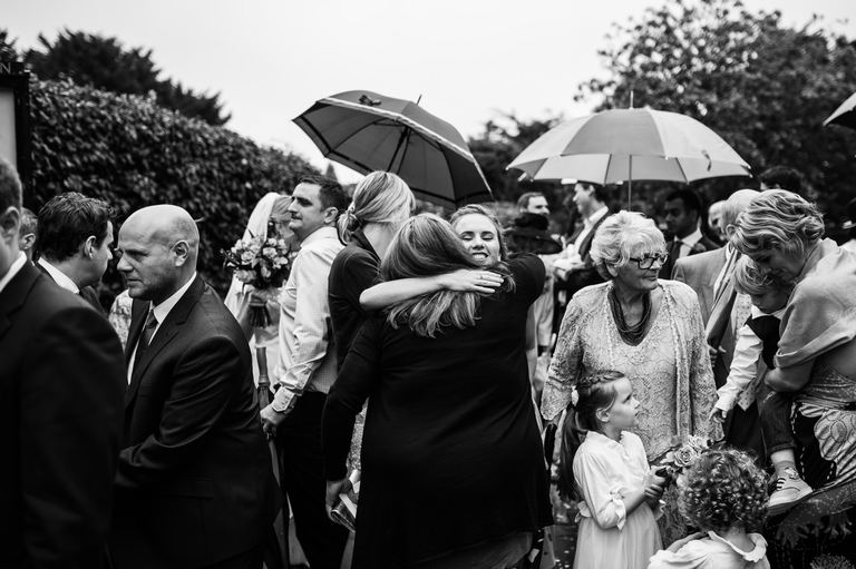 wet wedding outside umbrellas