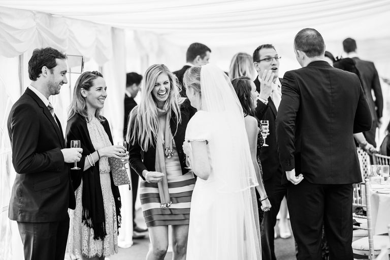bride sharing a joke with guests