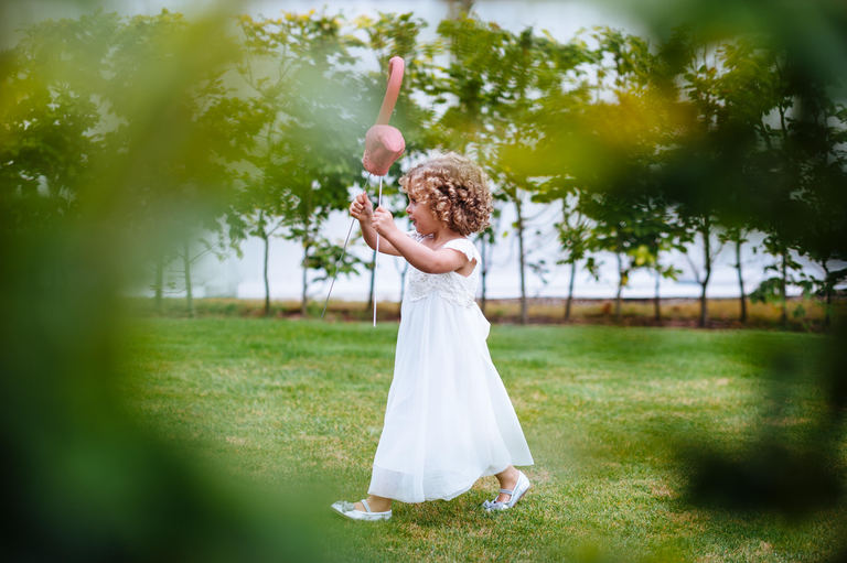 young bridesmaid holding a flamingo