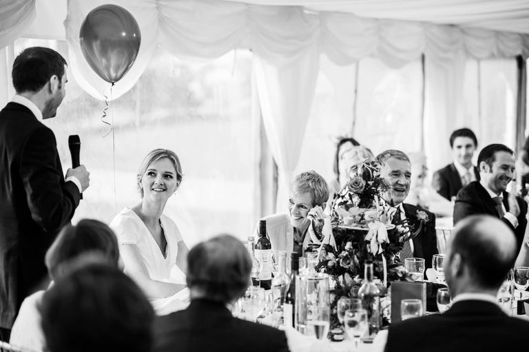 all smiles during the wedding speeches
