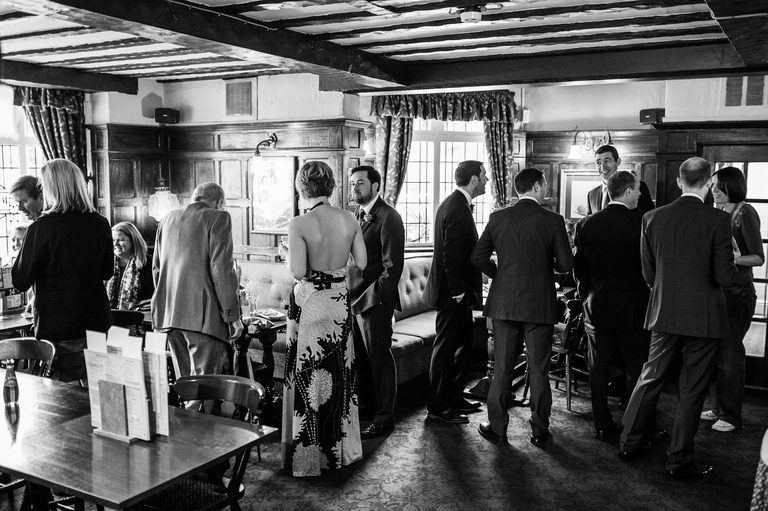 guests meeting in the pub before the wedding