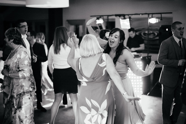 bridesmaid singing and dancing