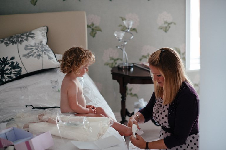 young wedding guest getting ready