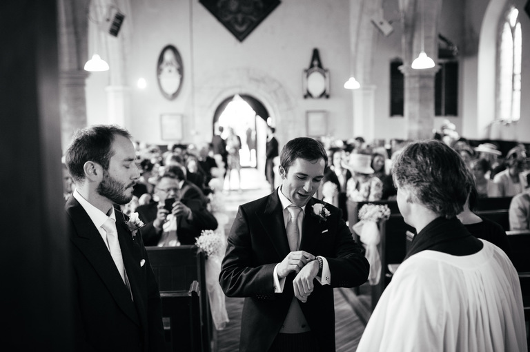 groom checking his watch