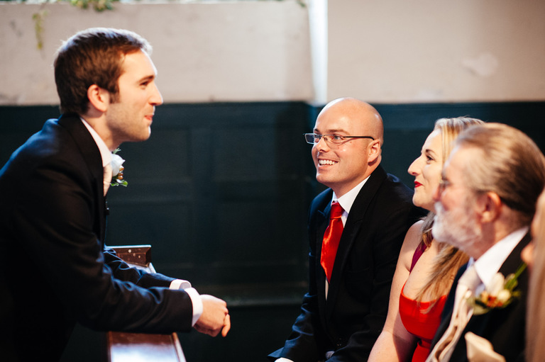 groom chatting guests