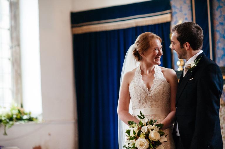 beautiful bride smiling at groom