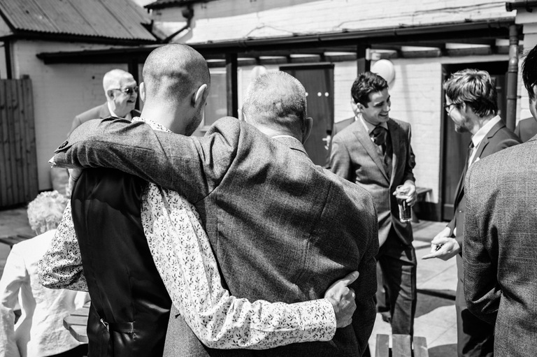 groom pre wedding hugs