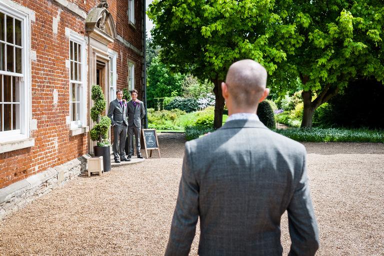groom arriving at wedding venue