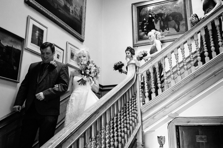 bridal party walking down staircase