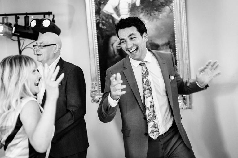 happy wedding guest dancing