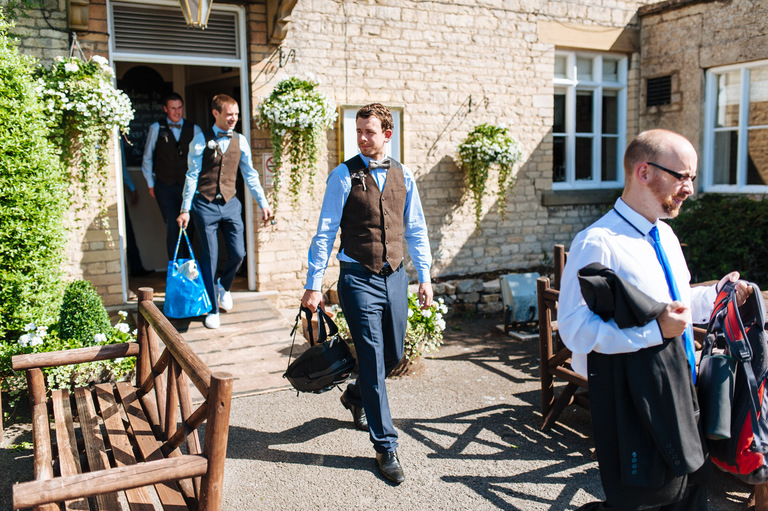 groomsmen leaving white horse pub
