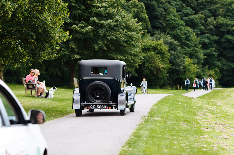 wedding car driving away rutland water