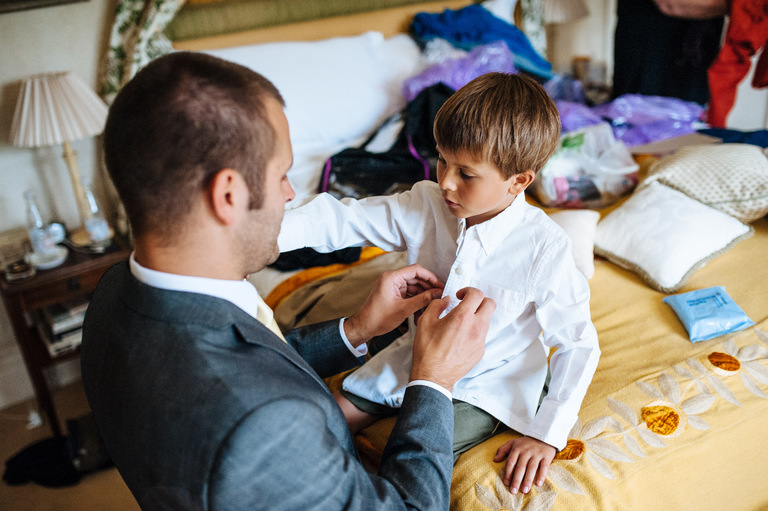 groom helping his son get dressed